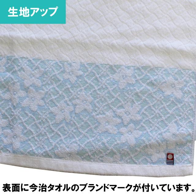 タオルの表面に今治ブランドのロゴマークタグが付いています。